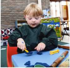 boy playing with playdough,image © Possums Playcentre