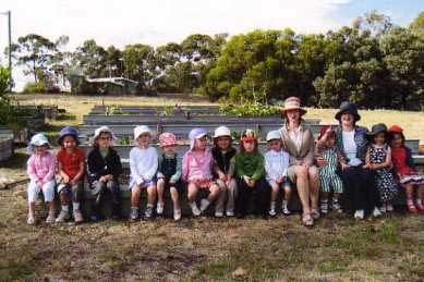 the children at their garden with Karin and Lyn, image © Possums Playcentre